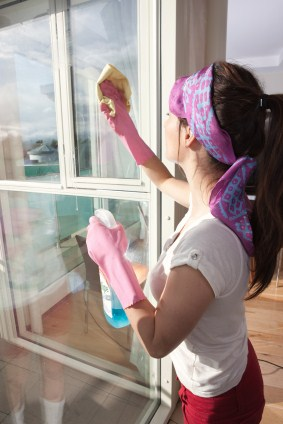 Window cleaning by Sparkling Faith Cleaning Services LLC - women cleaning window